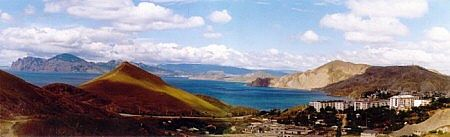 A panoramic view of the quiet town of Ordzonikidze in Crimea and the inactive volcano, Caradag